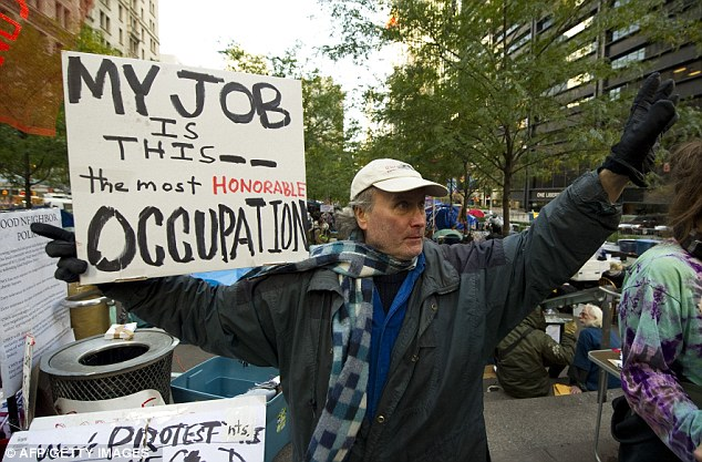 Demonstrations: An Occupy Wall Street protester on Broadway today, declaring he has made being part of the movement his full-time job