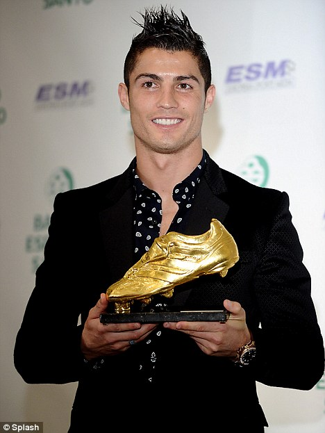 I got something sparkly too! Ronaldo poses with his Golden Boot which was handed to him for his tally of 40 goals in the 2010-2011 football season