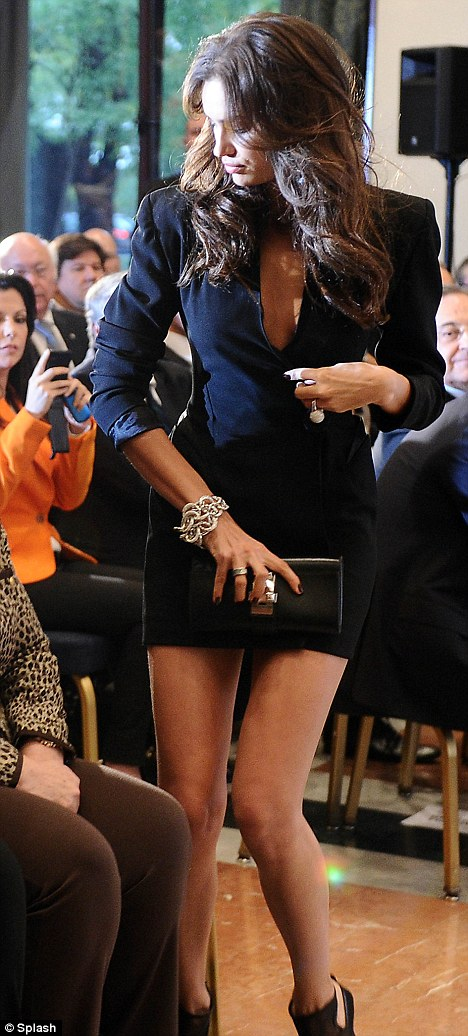 Rock and roll: Irina's ring is clearly visible on her left hand