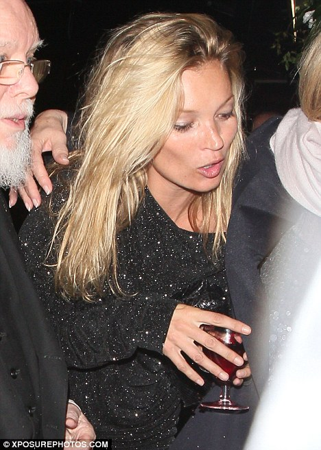 Bring your own drink: Kate Moss arrives to the Dazed & Confused 20th birthday party at the W Hotel carrying her own wine