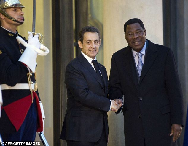 Going about his business: French President Nicolas Sarkozy (C) welcomes Benin's President Thomas Boni Yayi at the Elysee Palace in Paris today