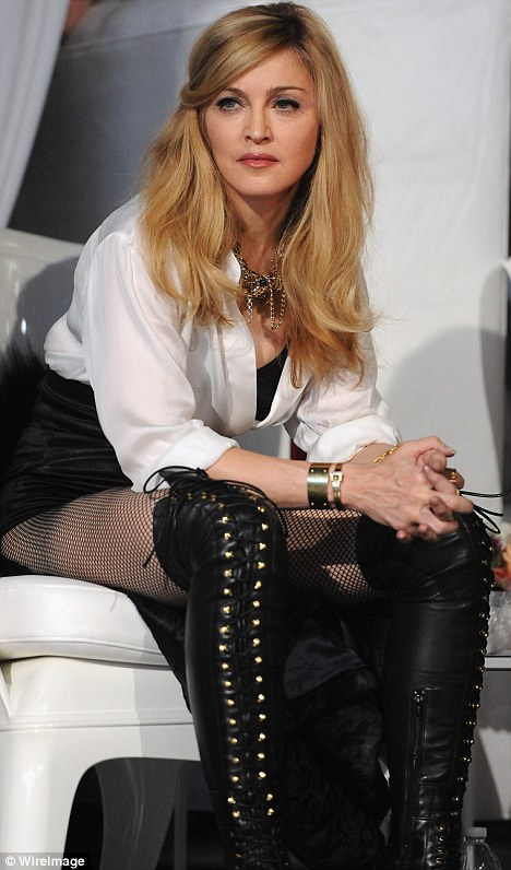 Back in the groove: Madonna in boots and hotpants