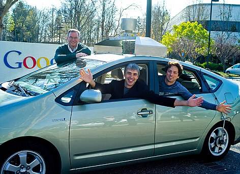 Google leadership Larry Page, Sergei Brin and Eric Schmidt in one of the company's fleet of self-driving cars