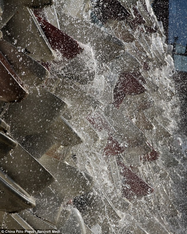 Splashback: Water thunders down the tower of toilets. The structure took two months to create