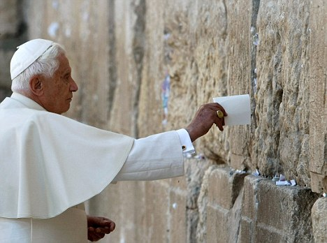 Pope Benedict XVI places a note in the Western Wall, Judaism's holiest prayer site, in Jerusalem's Old City May 12, 2009