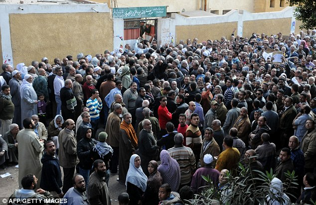Hundreds in waiting: Egyptian voters gather outside a school turned polling station in the Ain Shams district of Cairo