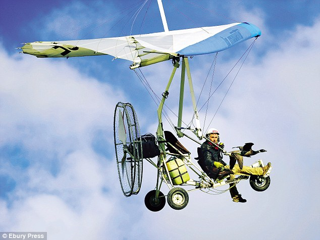 One of John Downer's team of cameramen, Christian Moullec, flying his microlight