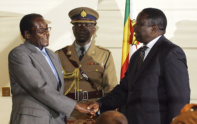 Mugabe (left) shakes hands with Tsvangirai: The prime minister has been repeatedly beaten and arrested by state police