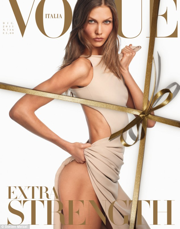 Karlie shows off her toned physique on the cover, wearing a Valentino dress