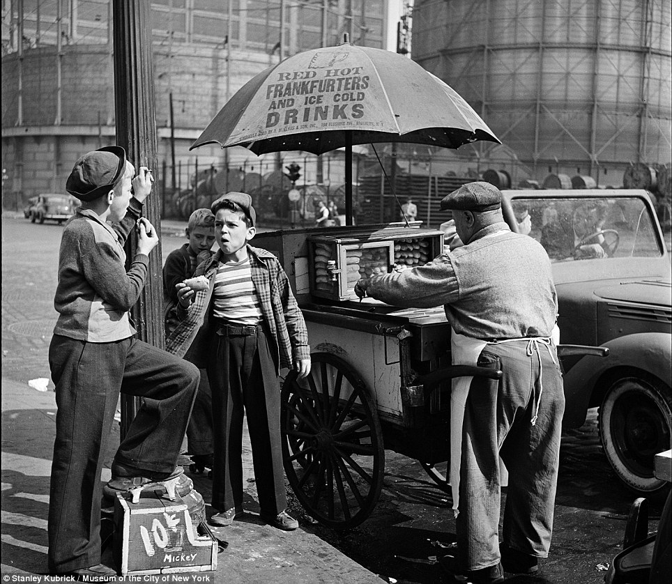 Street meat: A hot dog seller finds two customers in this shoe shine boys in 1947, one of whom appears to be called Mickey and charges 10 cents