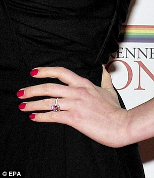 Pink effect: Anne's engagement ring sparkled so much it caught the reflection of the red-carpet making it appear to be of pink colour