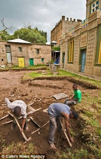 Workmen clear the ground adjacent to the Chapel of the Tablet
