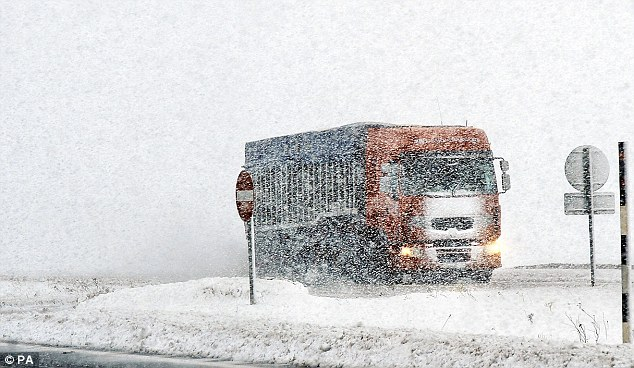 Struggle: A lorry makes its way along the A66 between Yorkshire and Cumbria today as the cold snap bites
