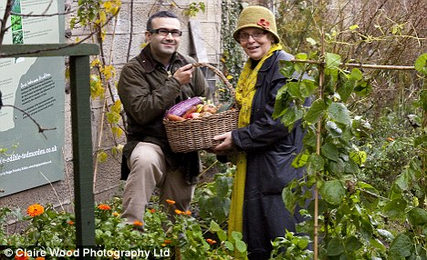 Incredible Edible is about more than plots of veg. It's about educating people about food, and stimulating the local economy (pictured Vincent Graff and Estelle)