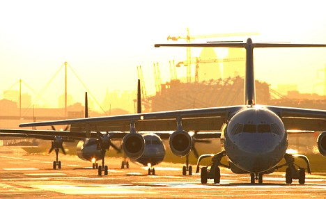 Waiting: Planes queue for take off at London City Airport - congestion could eventually send air fares skywards
