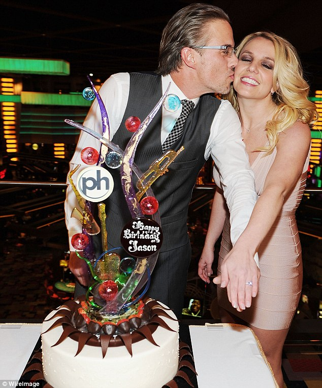 Posing up: Britney and Jason posed up with a huge birthday cake celebrating the agent's 40th birthday