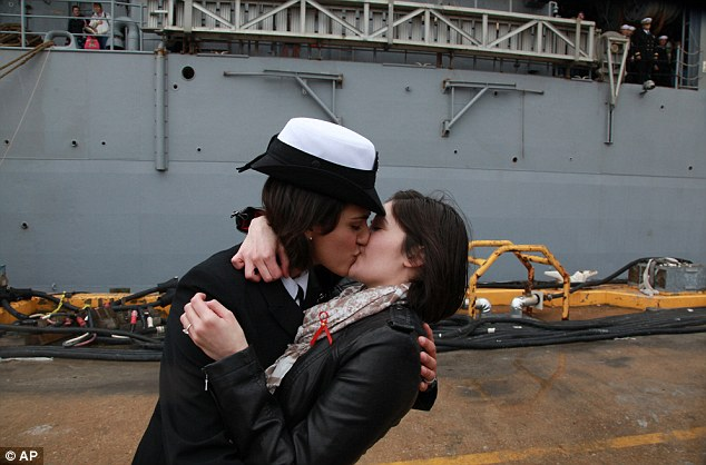 Pucker up: Petty Officer 2nd Class Marissa Gaeta, left, kisses her girlfriend of two years, Petty Officer 3rd Class Citlalic Snell in the first time a same-sex couple was chosen for Navy's traditional homecoming kiss