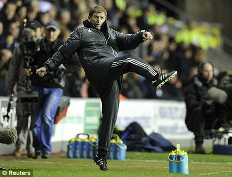 Sticking to his guns: Liverpool manager Kenny Dalglish