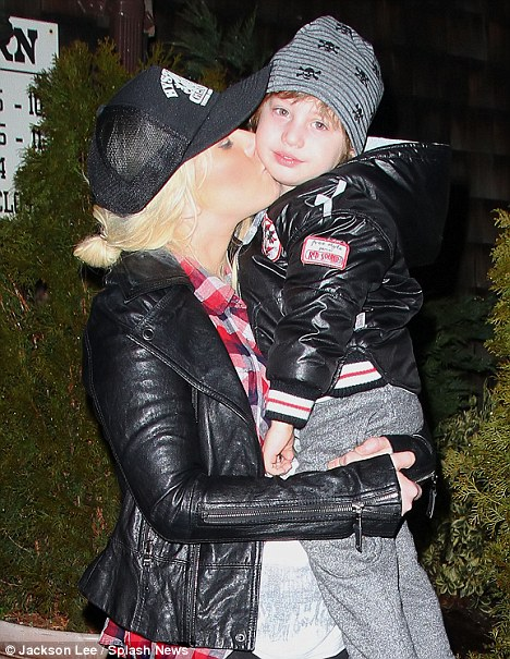 New start: Christina Aguilera kisses Max Bratman on the cheek when leaving The Barn restaurant in New Jersey yesterday