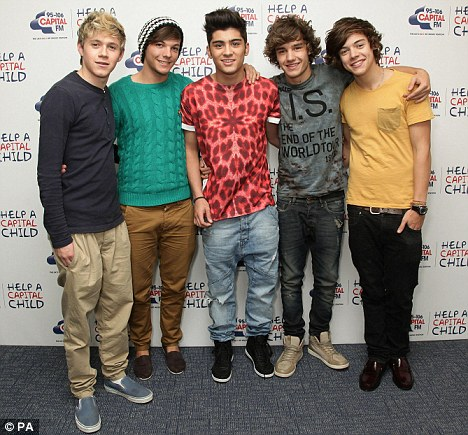 All together: Harry and Louis's bandmates Niall Horan (far left), Zayn Malik (centre) and Liam Payne also live in the luxury complex