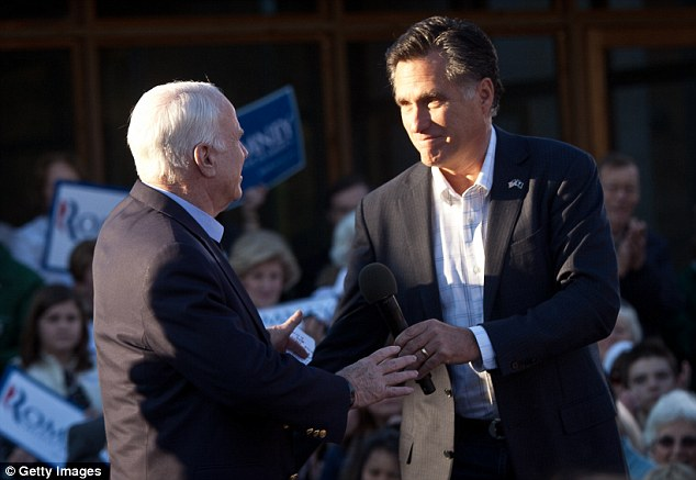 Campaign trail: Mr Romney thanks Senator John McCain at an event in Charleston, South Carolina, yesterday
