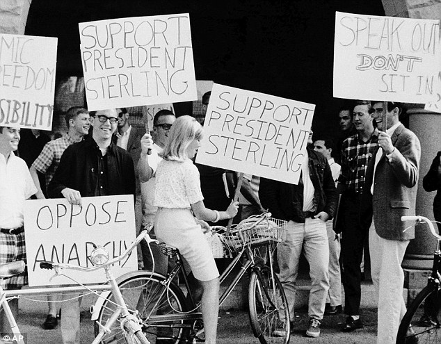 Taking a stand: A young Mitt Romney holds up a placard at a pro-draft demonstration at Stanford Univeristy in Palo Alto, California, in May 1966