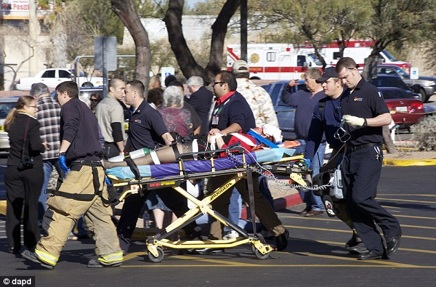 One year ago: On January 8, 2011, Gabby Giffords was rushed to the hospital on a gurney after being shot in the head at a congressional meet-and-greet
