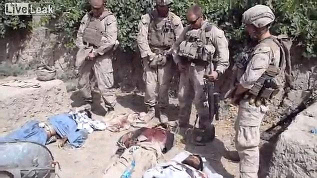 Horrifying: A video posted online claims to show four Marines urinating on dead bodies