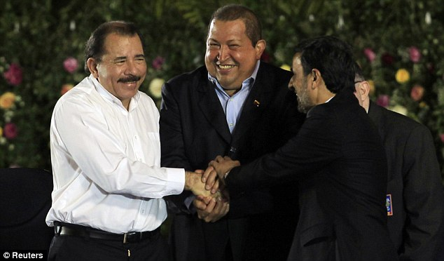 Ahmadinejad shakes hands with Chavez and Ortega