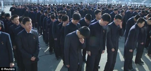 Upset: Students of Pyongyang Secondary School No. 1 gather wipe their eyes as they mourn