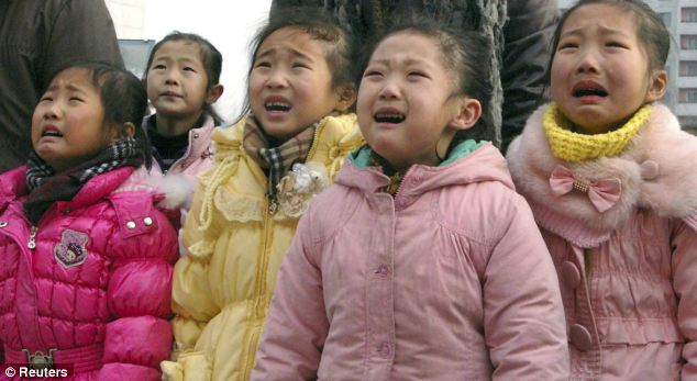 Weeping: Children weep at the death of the supreme leader