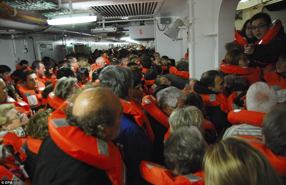A photo taken by Spanish passenger Carlos Carballa on board cruise ship as panicking passengers wait to be evacuated