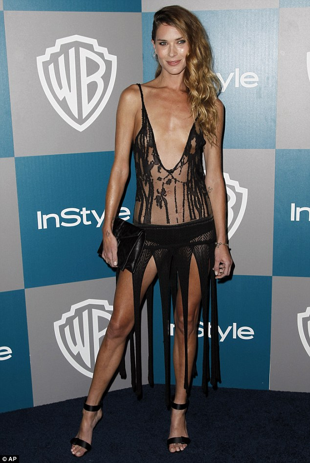 Shredded and salacious: Model Erin Wasson wore next to nothing as she demanded attention on the red carpet at the InStyle Golden Globes after party last night