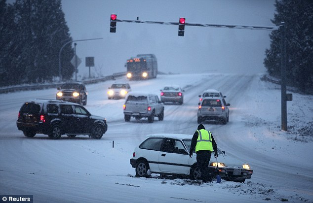 Hitting hard: State troopers in the northwest reported 95 accidents in eight hours in what many residents dubbed 'Snowmageddon' while central states dodged 10 tornadoes