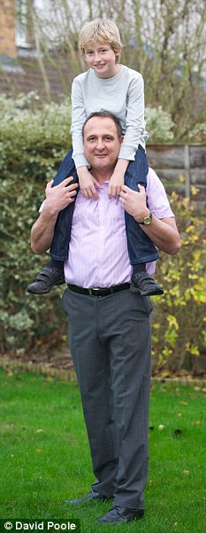 Steve Hall, wearing his shoes, while carrying his son Matthew