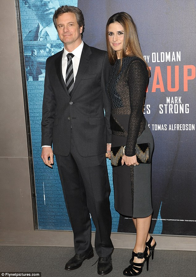 How chic: Colin Firth and his wife Livia Giuggilo matched ensembles by teaming grey with black