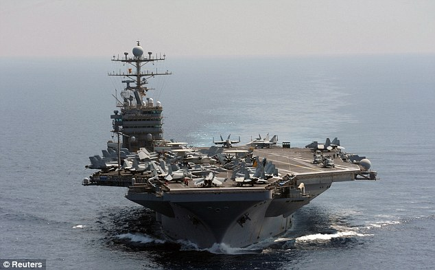 Sabre-rattling: The Nimitz-class aircraft carrier USS Abraham Lincoln sailed through the Strait of Hormuz and into the Persian Gulf on Sunday