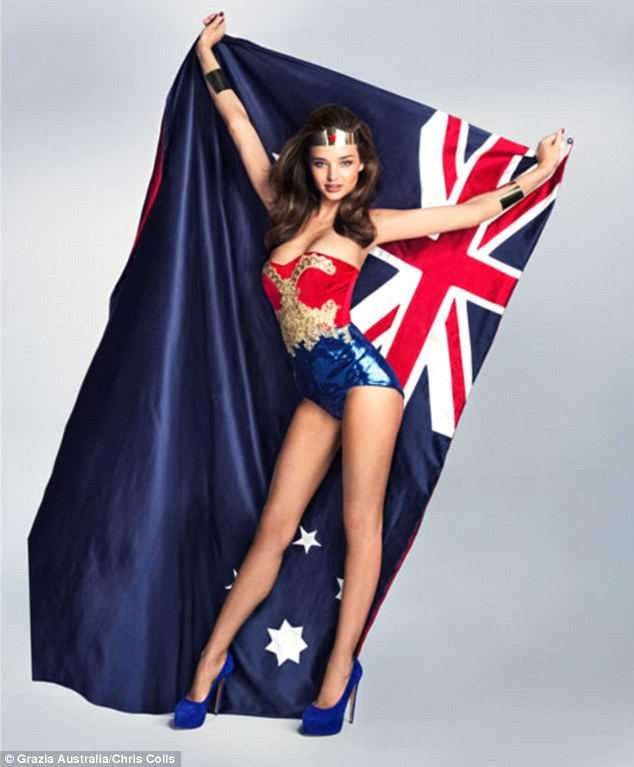 But Can She Leap Tall Buildings In A Single Bound Miranda Kerr Poses As Wonder