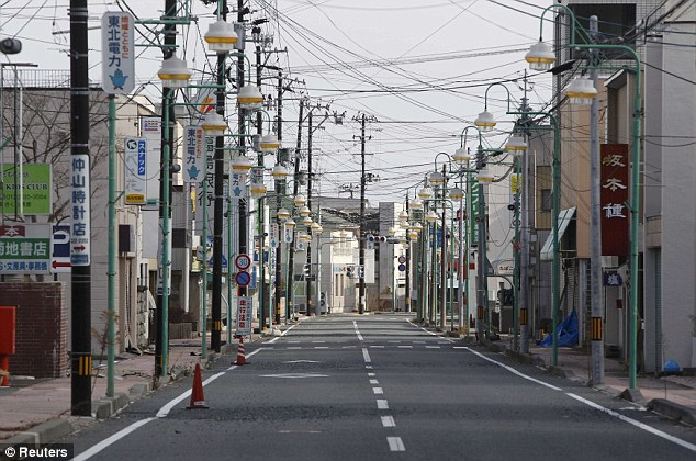 Ghost town: An empty shopping street in Tomioka town, within the 20km Fukushima exclusion zone. If there had been a full meltdown at the plant, everyone within a 105-mile radius would have to have been evacuated