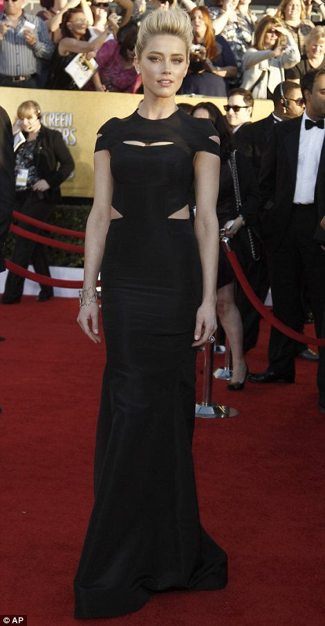 Cut out creation: Amber Heard donned a cut out gown by Zac Posen which she teamed with a oversized quiff hairstyle