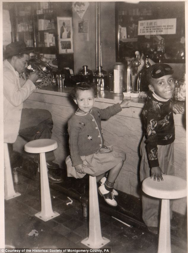 America during wartime: Smiling kids at the soda fountain bring the viewer back stateside to the mid 1940s, showing what the era was like for those left at home