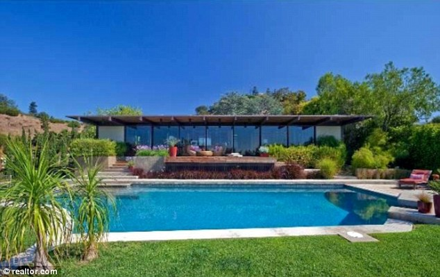 Fancy a dip? The home's rectangular pool is certainly inviting