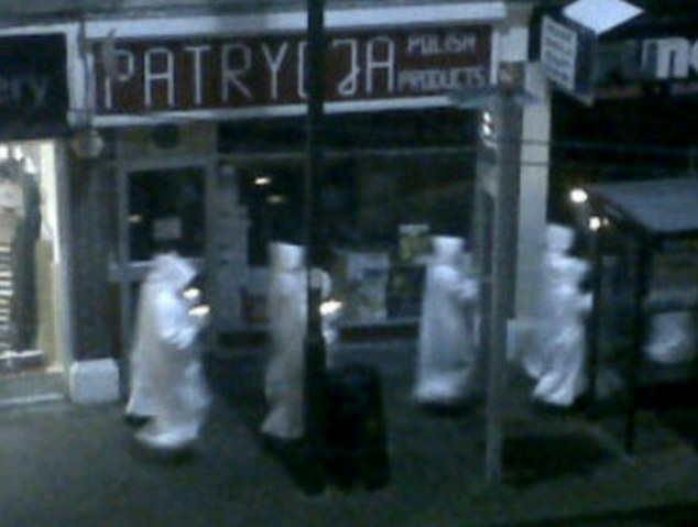 Suspicious: The image appears to show a group of people dressed as members of racist group the KKK walking through Essex