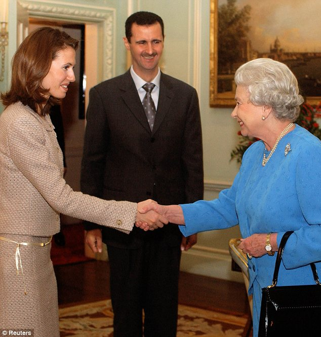 Royal connections: The Queen (right) met Syrian President Bashar Assad (centre) and his wife Asma (left) at Buckingham Palace in 2002
