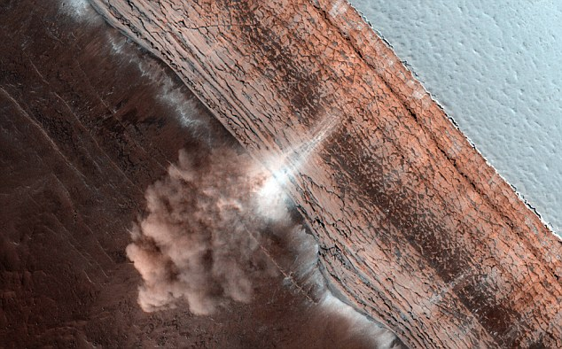 Fine ice and dust cascades over a martian polar cliff in March 2010 in another picture captured by the Mars Reconnaissance Orbiter's HiRISE camera