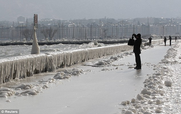 Slippery: The ice-covered promenade on the bank of Lake Leman in Geneva
