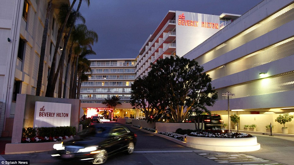 Dramatic scene: Tonight party carried on as planned at the Beverly Hilton Hotel where Whitney died earlier today