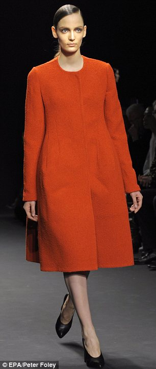 Clever coats: The earth toned outer wear in luxurious fabrics looked comfortable and stylish on the models