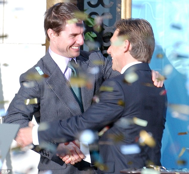 Actor and Scientologist Tom Cruise (left) hugs Church leader Mr Miscavige, who was labelled an autocrat in an email Mrs Cook sent to 12,000 worshippers