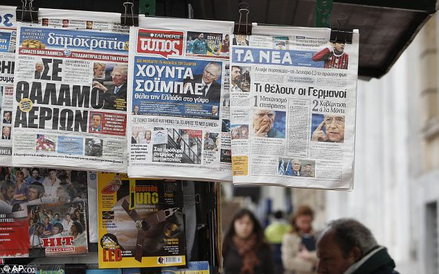 The front pages of three Greek newspapers, depicting German Finance Minister Wolfgang Schaeuble, from left to right, Dimokratia